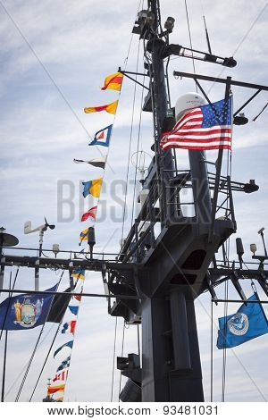 STATEN ISLAND, NY - MAY 24 2015: The American Flag mounted on the ships mast of the USCGC Spencer (WMEC 905) a Medium endurance cutter at Sullivans Pier during Fleet Week NY 2015.