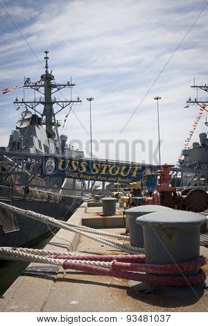 STATEN ISLAND, NY - MAY 24 2015: The ships banner of the guided-missile destroyer USS Stout (DDG 55) hangs from the metal gangplank while moored at Sullivans Pier during Fleet Week NY 2015.