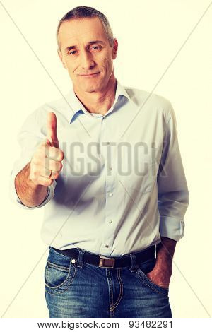 Handsome mature man gesturing ok sign.