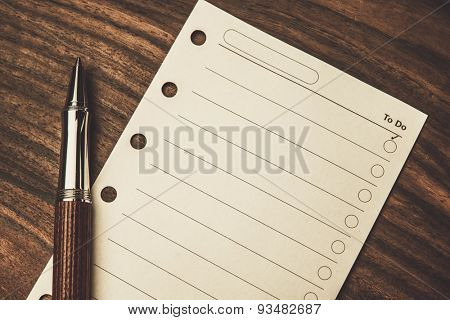 Luxurious rollerball pen and empty to do list