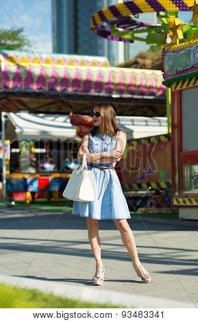 Beautiful Girl At The Amusement Park