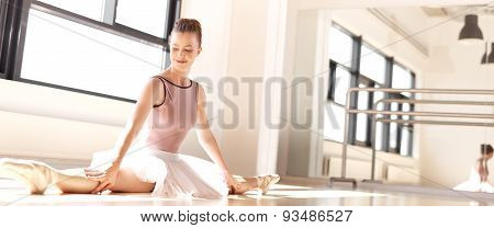 Young Ballerina In Pink Doing Splits In Studio