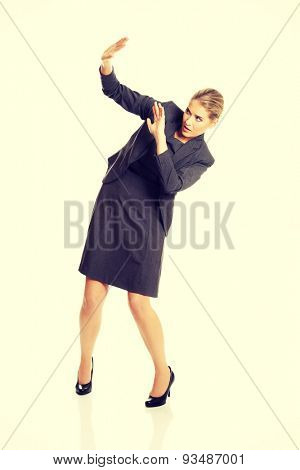 Businesswoman trying to protect herself.