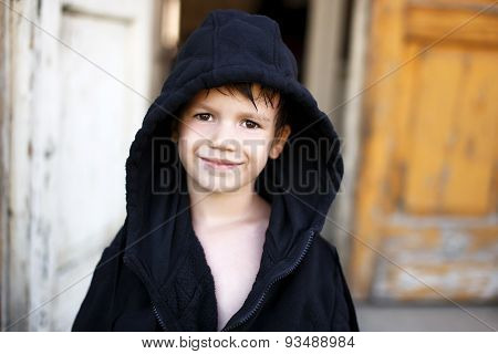 Little Boy In Black Bathrobe Drying