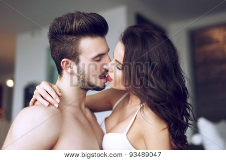 Sexy Couple Kissing At Home