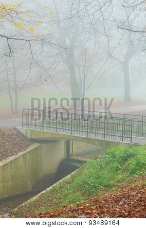 Bridge In Autumn Misty Park