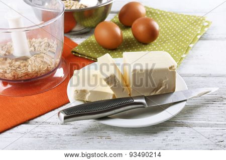 Ingredients for oatmeal cookies on wooden table, closeup