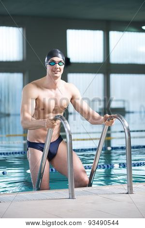 Professional Swimmer Using Ladder