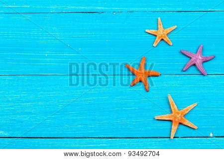 starfish on painted rustic wooden boards