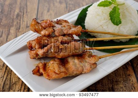 Grilled Spice Pork Skewer With Sticky Rice On Plate