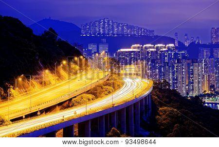 highway traffic road to city downtown at night, hong kong city
