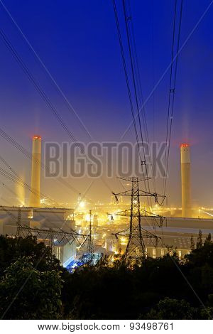 Power station with smoke at night