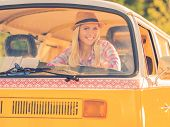 pic of recreational vehicles  - Happy young woman smiling at camera while looking through the vehicle window - JPG