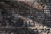 pic of old stone fence  - texture of old brown laterite stone vintage wall grunge surface shadow - JPG