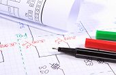 image of drawing  - Rolls of electrical diagrams and accessories for drawing lying on construction drawings drawings and accessories for the projects engineer jobs - JPG