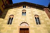 stock photo of windows doors  - sunny day italy church tradate varese the old door entrance and windows mosaic - JPG