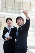 image of korean  - Korean young business couple taking selfie outdoors