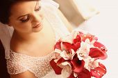 pic of calla  - Beautiful bride holding a white and red calla lily - JPG