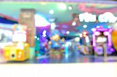 stock photo of arcade  - Blur or Defocus Background of Arcade game Zone in Shopping Center - JPG