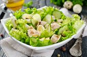 stock photo of liver  - Vegetable salad with cod liver seasoned with lemon sauce - JPG