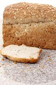 foto of whole-wheat  - whole wheat bread sliced on marble table white background - JPG