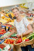 Lady choosing fruit and veg poster