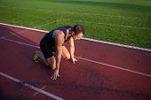 picture of sprinter  - Sprinter leaving starting blocks on the running track - JPG