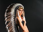 foto of nativity  - Beautiful woman in native american costume with feathers  - JPG