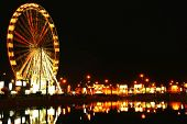 stock photo of amusement park rides  - Amusement park at night - JPG