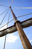 foto of mast  - Mast and sail of an old wooden sailboat  - JPG