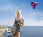 Blonde In A Green Pareo  On Beach With Baloon In Sky poster