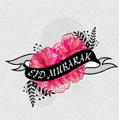 picture of eid al adha  - Beautiful pink flowers covered by black Eid Mubarak ribbon for muslim community festival celebration - JPG