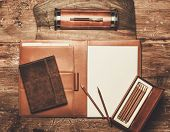 pic of leather tool  - Luxurious writing tools on a wooden table  - JPG