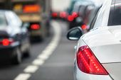 image of tail  - Rush hour traffic congestion focus on tail brake light - JPG