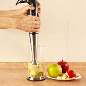 stock photo of blender  - Hands chefs cooked prepare fruit cocktail in a blender - JPG