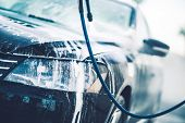 image of pressure-wash  - Vehicle in the Car Wash Covered by Active Washing Foam - JPG
