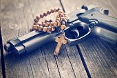 picture of prayer beads  - the rosary beads and gun - JPG