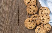 image of chocolate-chip  - Cookies chocolate or chocolate chips on a wooden table - JPG