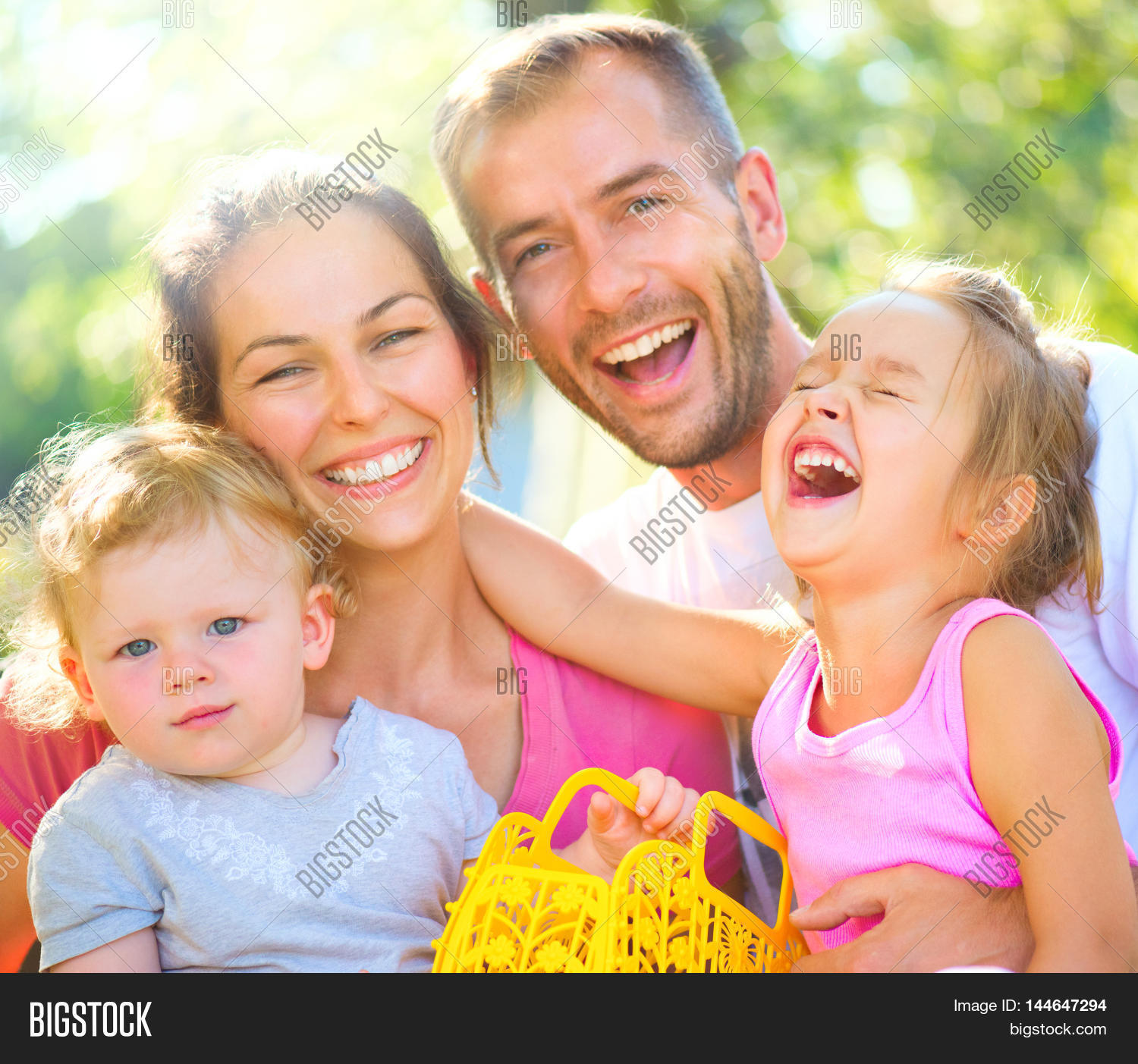 Happy Joyful Young Family Children Image & Photo   Bigstock: http://www.bigstockphoto.com/image-144647294/stock-photo-happy-joyful-young-family-with-children-father%2C-mother-and-little-kids-having-fun-outdoors-in-orchard-garden%2C-playing-together-in-summer-park-mom%2C-dad%2C-kids-laughing-and-hugging%2C-enjoying-nature
