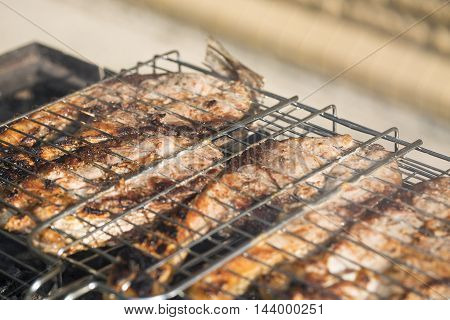 pieces of silver carp roasted close up on grill plate tasty diet fish meal.