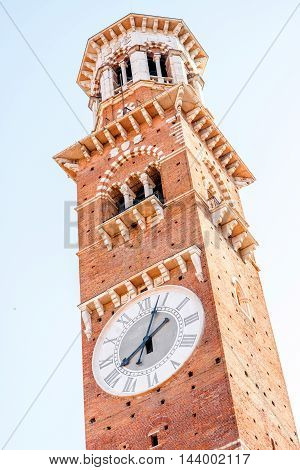 Close-up view on Lamberti tower with clock in Verona city in Italy