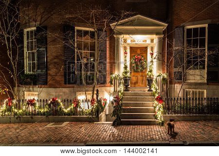 Christmas, a decorated house with garland and lights at night