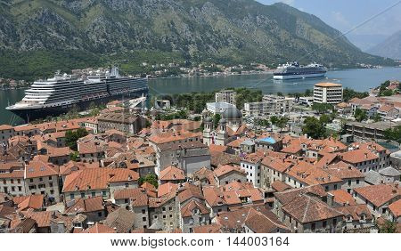 Kotor Montenegro - June 26th 2016. The historic old town of Kotor is visited by two huge cruise ships at the start of the tourist season.