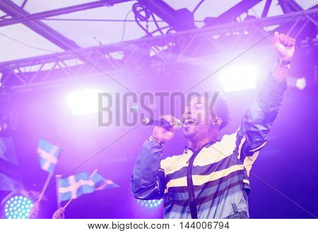 STOCKHOLM SWEDEN - AUG 21 2016: Swedish pop artist John Lundvik singing the swedish olympic song 2016 when swedish olympic athletes are celebrated in Kungstradgarden StockholmSwedenAugust 212016