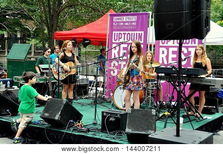New York City - August 6 2010: An all-girl band performs at a Summer Streets event on Park Avenue