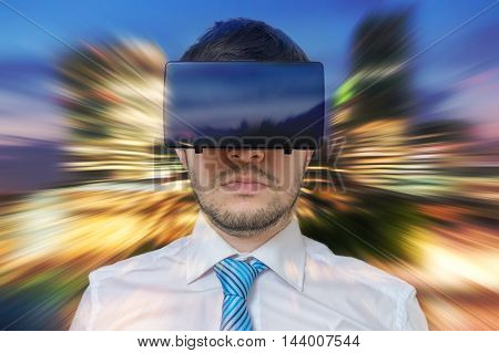 Young Businessman Is In 3D Simulation Of City. He Is Wearing Vir