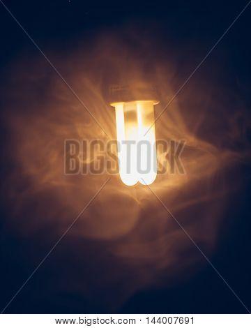 fluorescent lamp, warm light in fog
