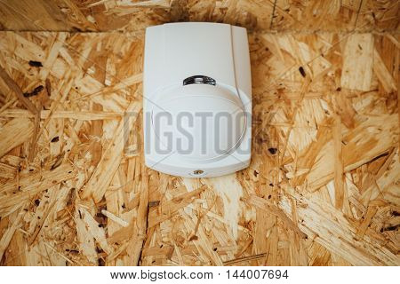 motion detector (sensor) in action, osb wall background