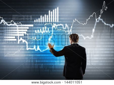 Businessman standing with back and using media virtual screen
