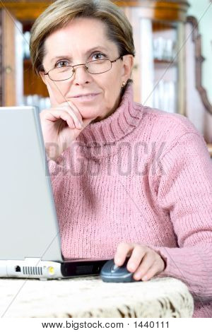 Woman Working On Notebook